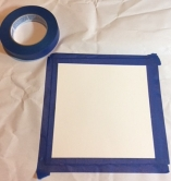 Anchoring your watercolor paper down to the protective surface.